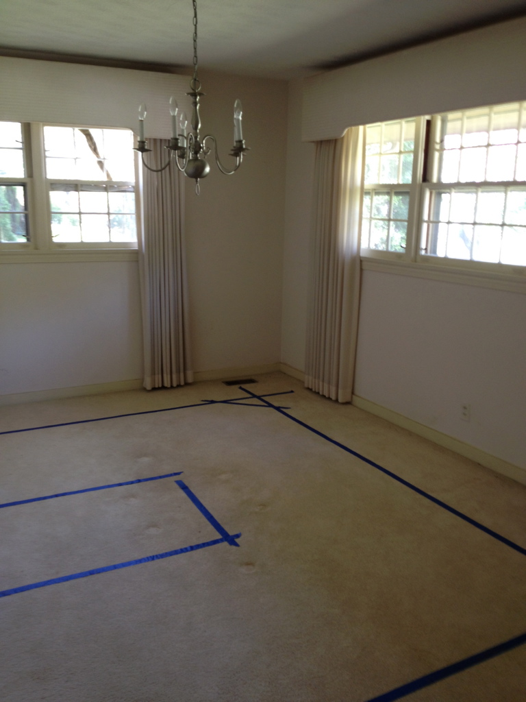 Before. We took this original dining room to be part of the new kitchen. You can see where the new island will be.