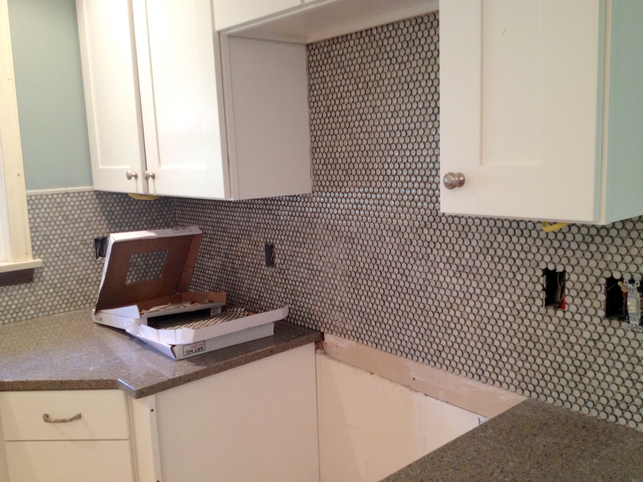 Close up of the beautiful penny tile that we used before the grout was applied.