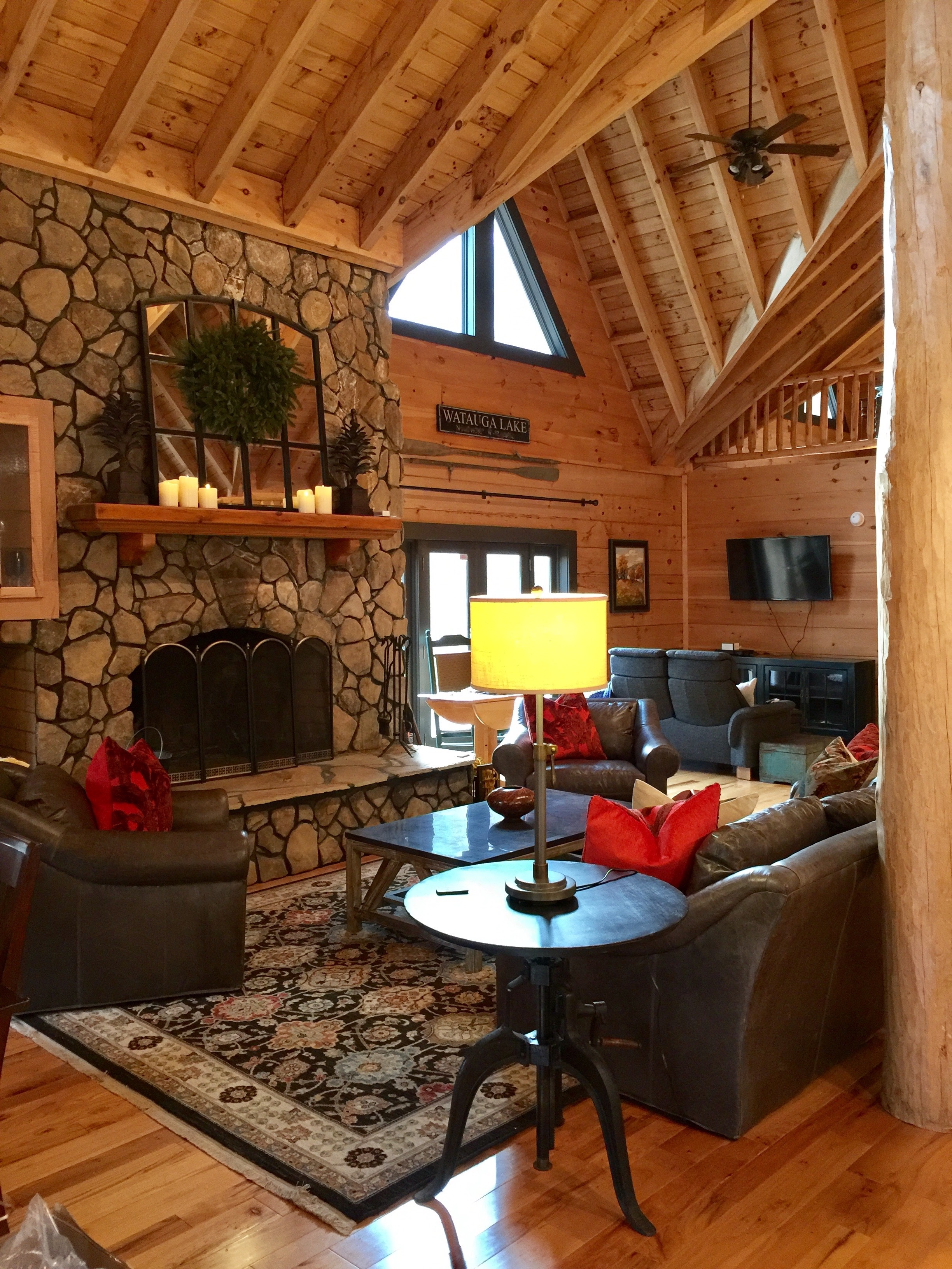 The charcoal painted trim stands crisply against the texture of the logs.