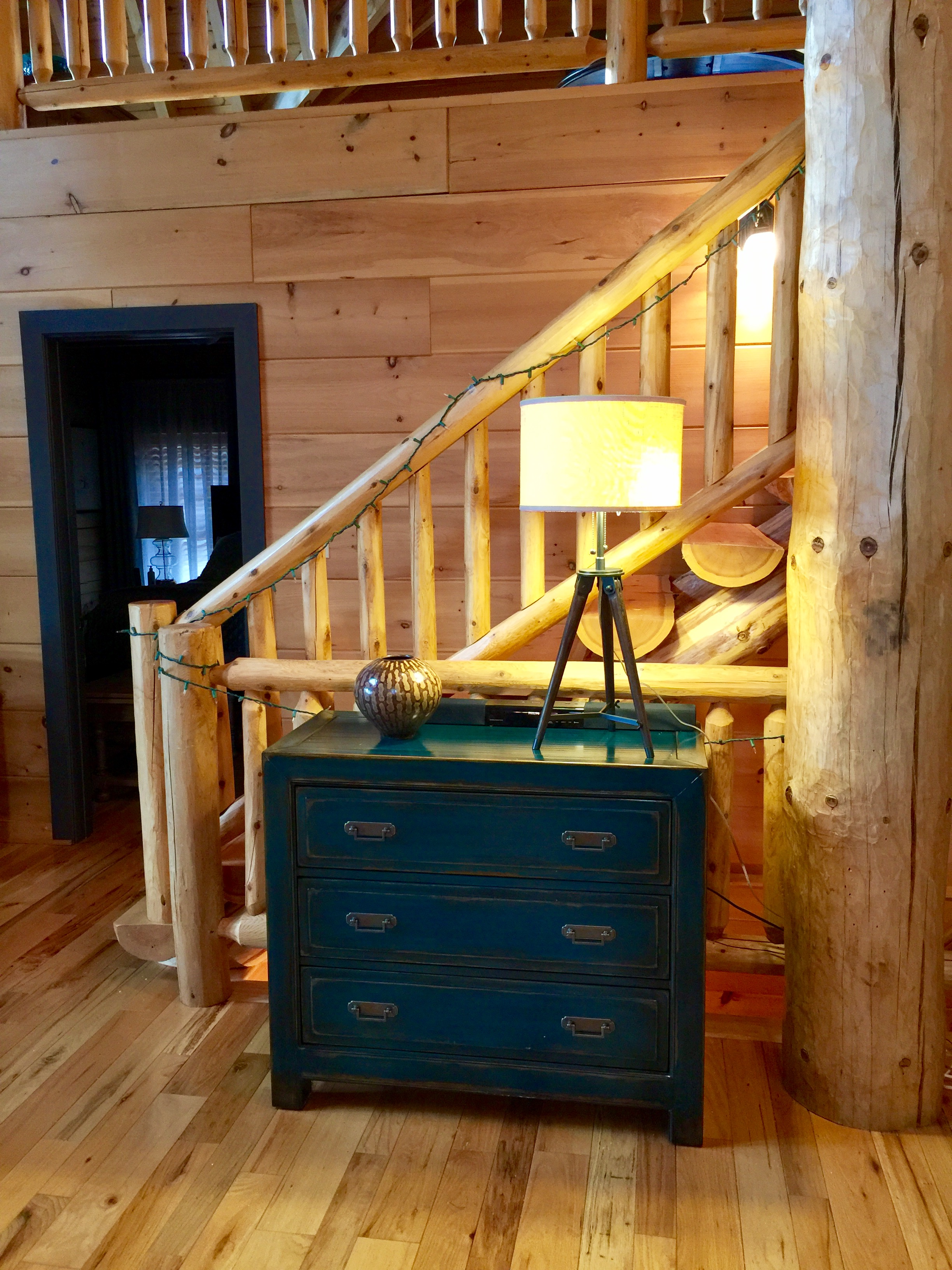 Beautiful teal chest with distressed finish adds a pop of color.