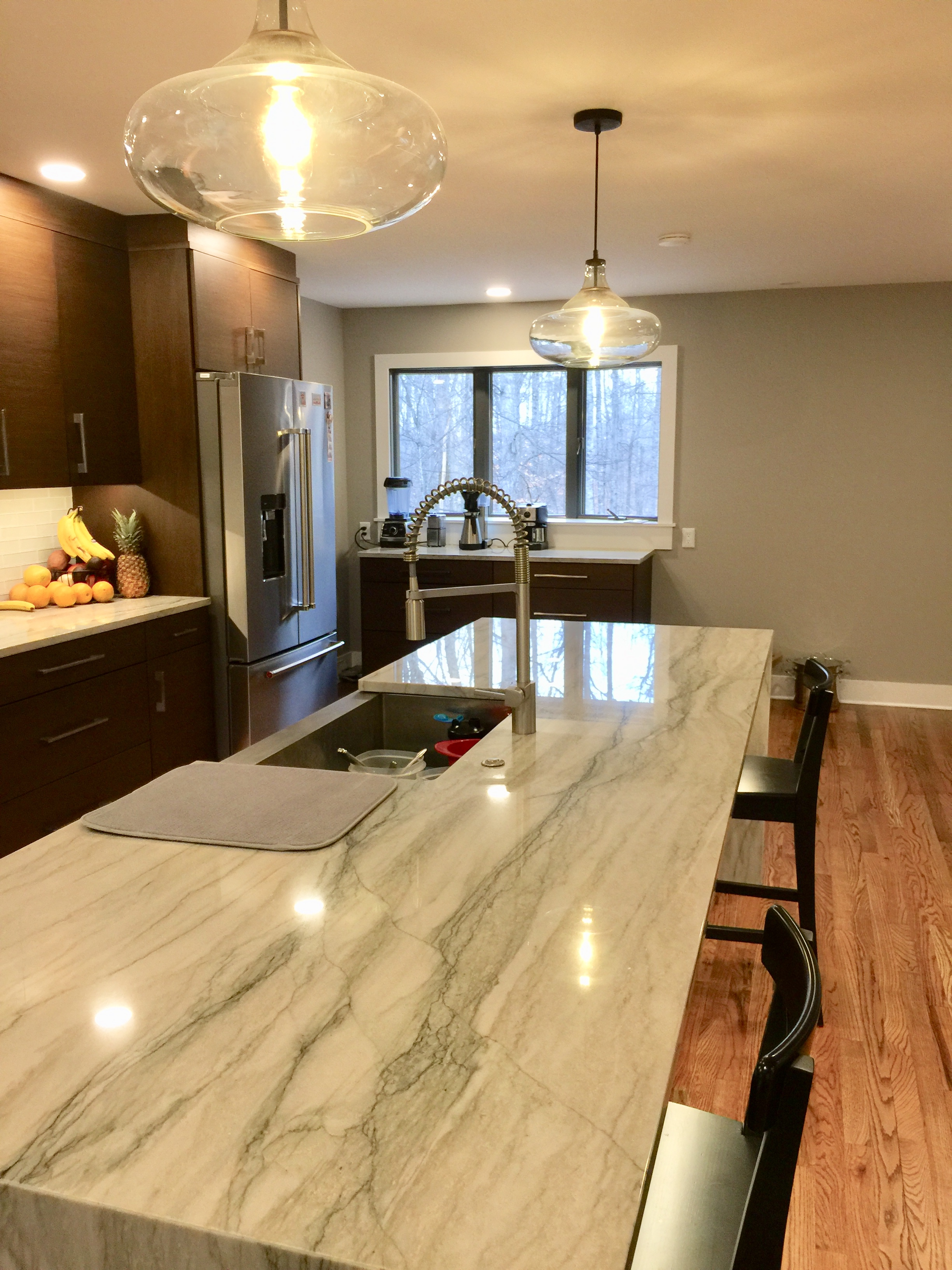 The Sea Pearl Quartzite they chose is outstanding. Note the coffee bar in the back.