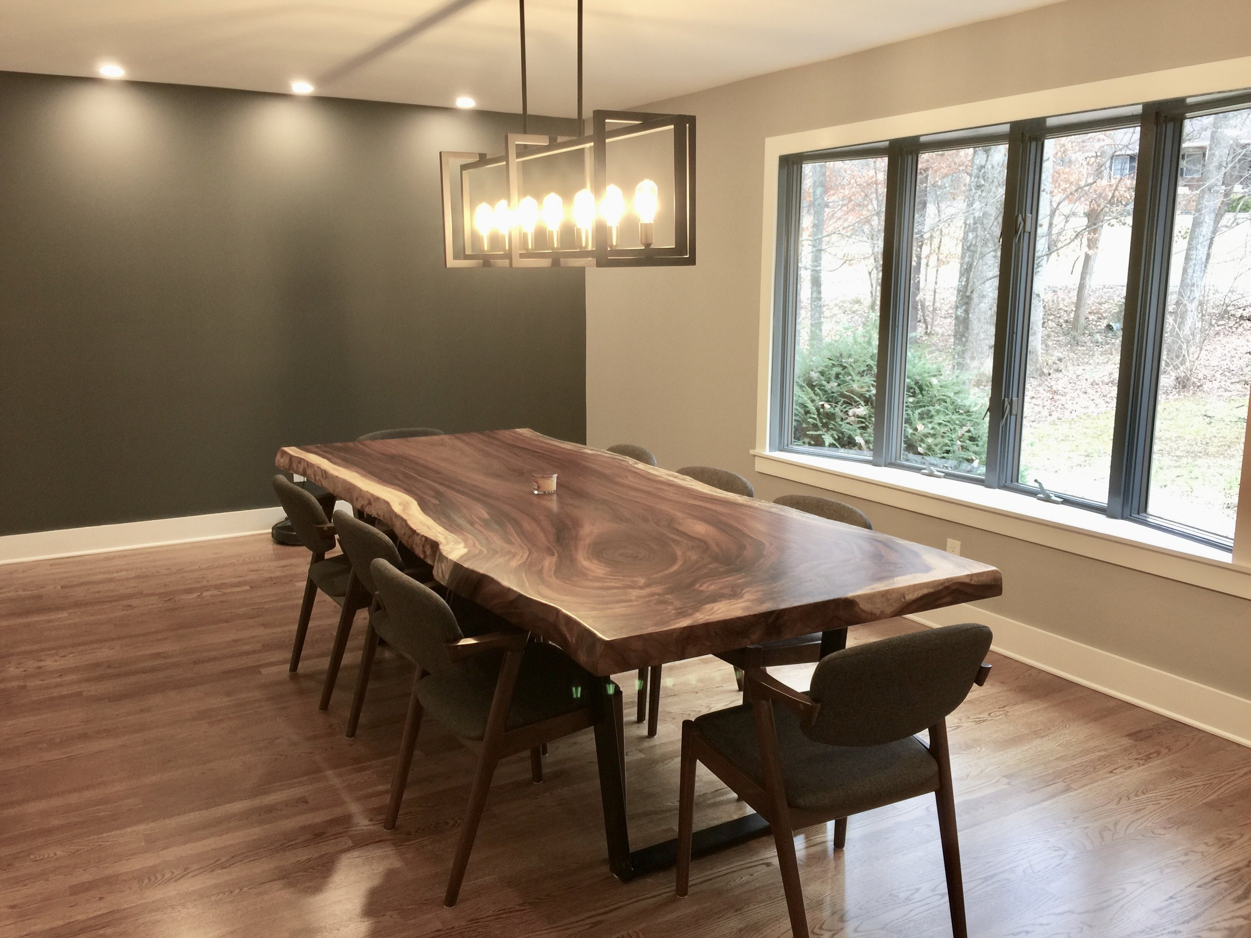 The bespoke live-edge dining room table was built by a woodworker in Blowing Rock, NC.