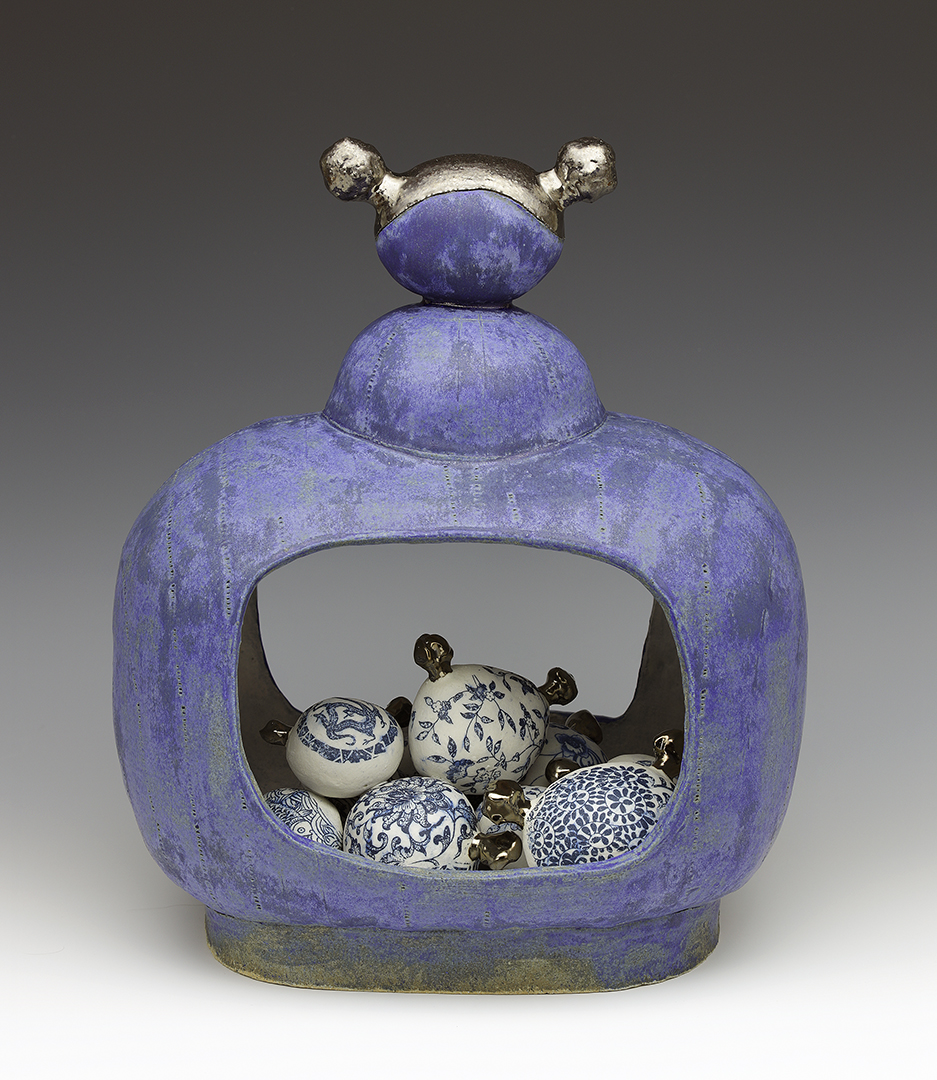 "This is how I riff—how one piece leads to another. The patterns on the little ""heads"" are like china patterns. Blue and white china reminds me of my mother. And china patterns led to the creation of my China Dolly Wallies. -  Sara Swink"