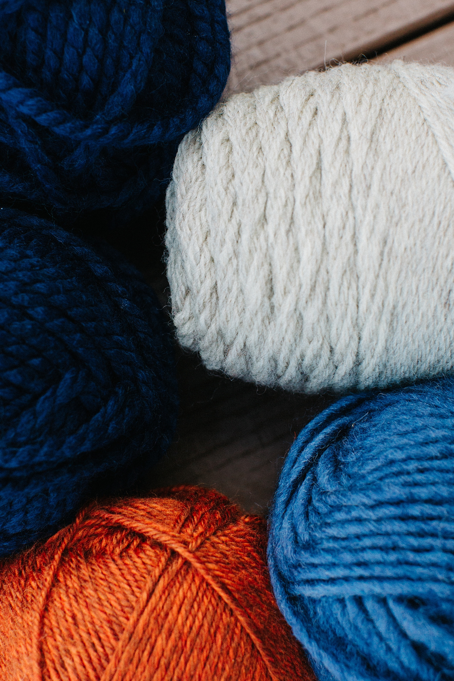 Tip:  Yarn selection .  Select your primary color in both a lighter and darker shade.  Then two complimentary colors for accent.  For this Fiber Art Wall Hanging we used blue as our primary and orange and a heather white as our complimentary colors.