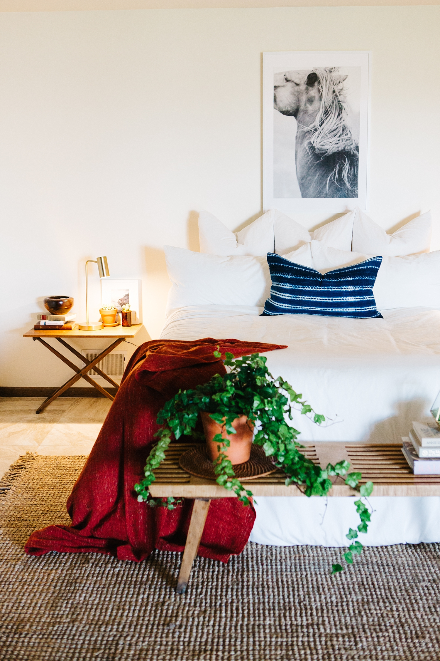 The monstrous sprawling ivy combined with the throw on the bed provide a great pop of color. The wonderful thing about having a white space is the ease in which color adds both warmth and homeyness.