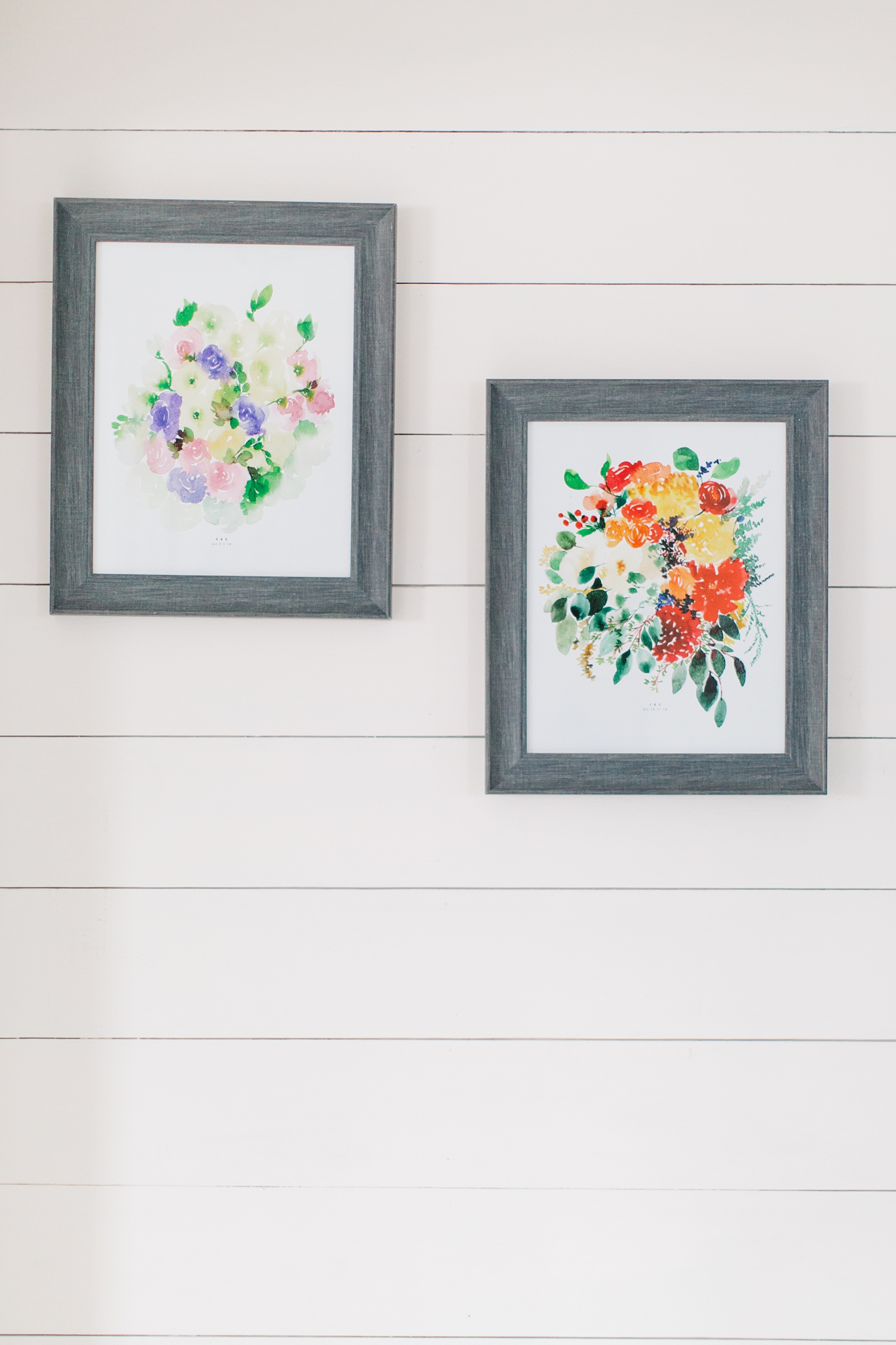 Watercolor portraits of Bethany & Julie's wedding bouquet's hanging in their cottage studio.