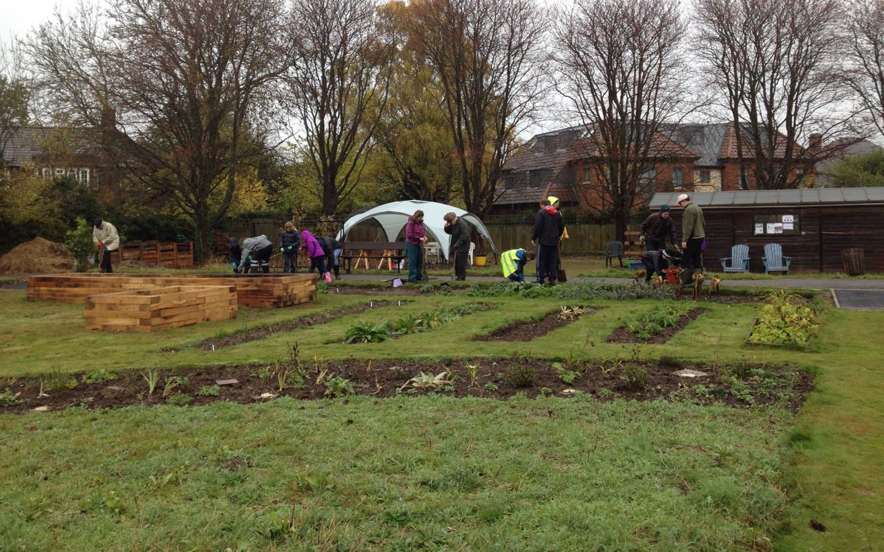 At the start of planting - even more cubs and helpers came later on. Spot the new raised beds too.