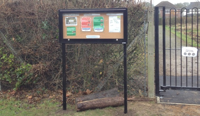 New noticeboard next to the new self-closing gate. We have now closed up the gap under the gate with mesh.