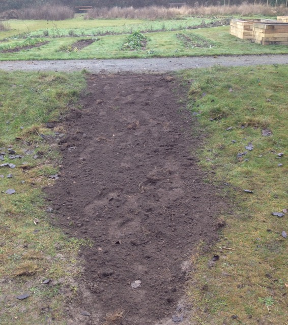 The old broken tarmac path to the club hut has been removed, ready for re-turfing.