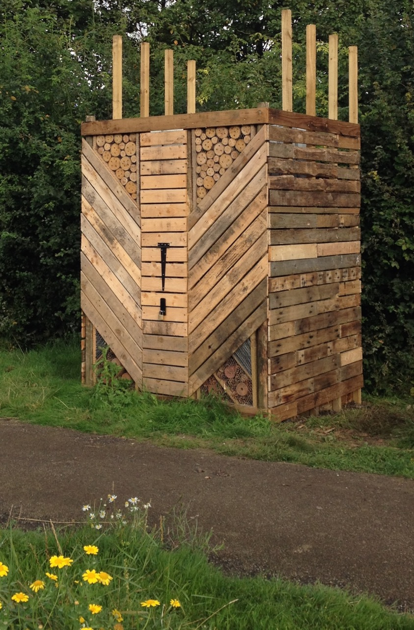 The almost finished water tower bug hotel - we have another drilled panel to put onto the front and need to design a roof...