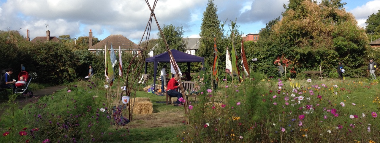 The chill out area - with flags, which is on its way to becoming a living willow hidey place. magic carpet making in the background.
