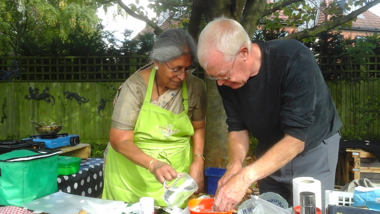 Siva and Keith at her Indian cookery demo - under the trees