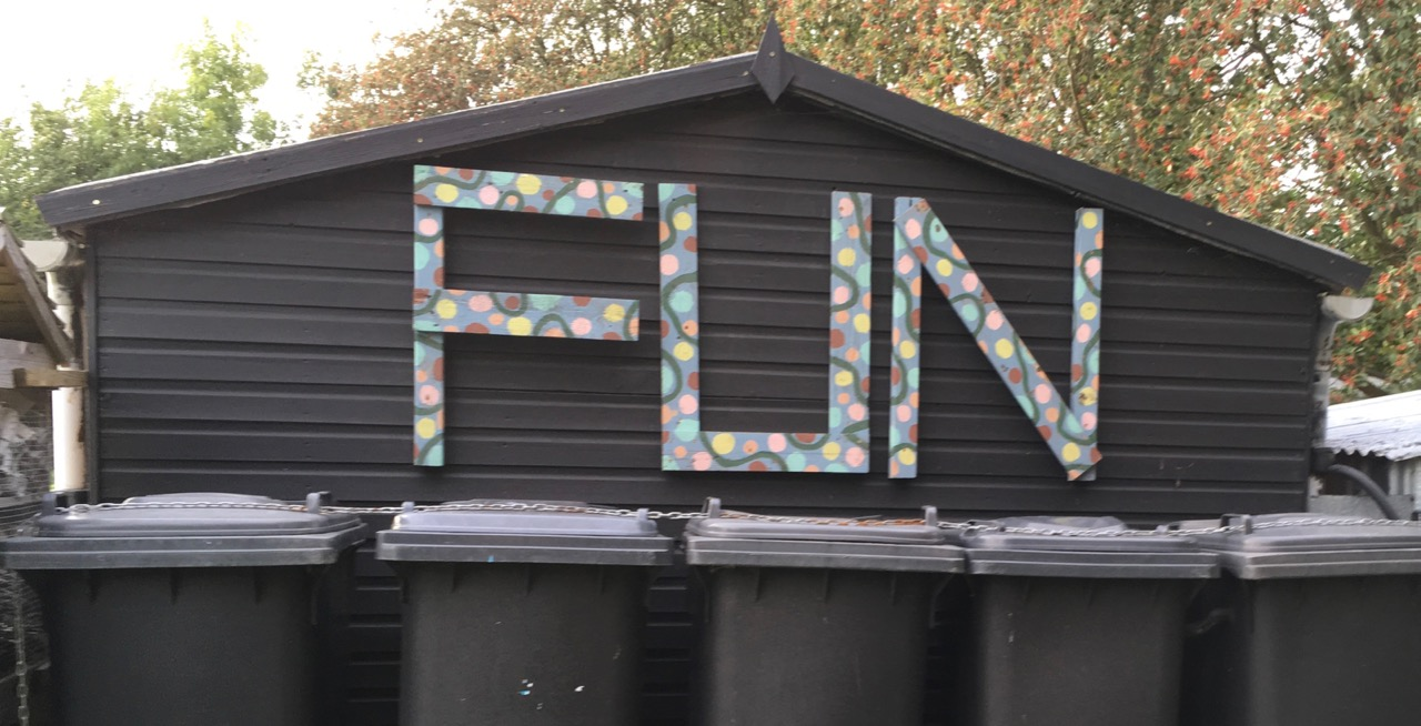 We made these from pallet wood for Funpalace 2017, and then used them at the Share Fair on Saturday. Rather than propping them up against a tree again until the next event we thought we'd attach them to the club hut. A reminder that the garden is a place of FUN, or at least if you are in the mood… multi-coloured paint (as tester pots) from Cambridge Community Scrapstore.