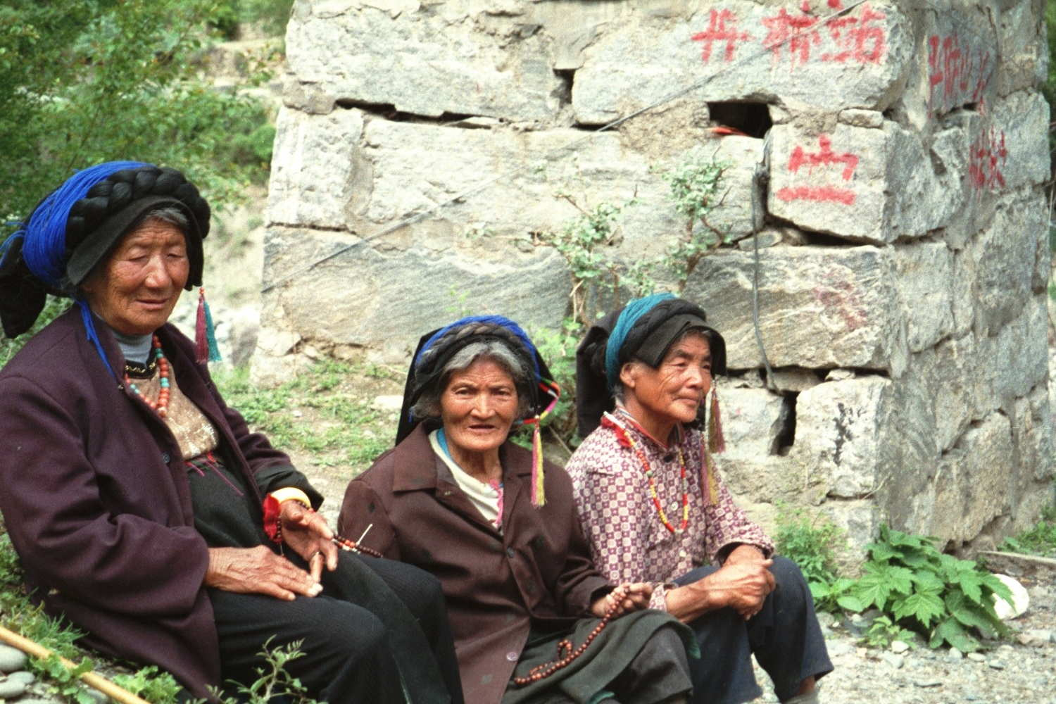 """Badi, China - I spent a good hour just sitting quietly with these women. They live in the very difficult to reach, but breathtakingly scenic hamlet of Badi (about eight hours from Tagong in Sichuan province) practice """"Anamism"""" - the worshiping of spirits in rocks, the trees, rivers."""