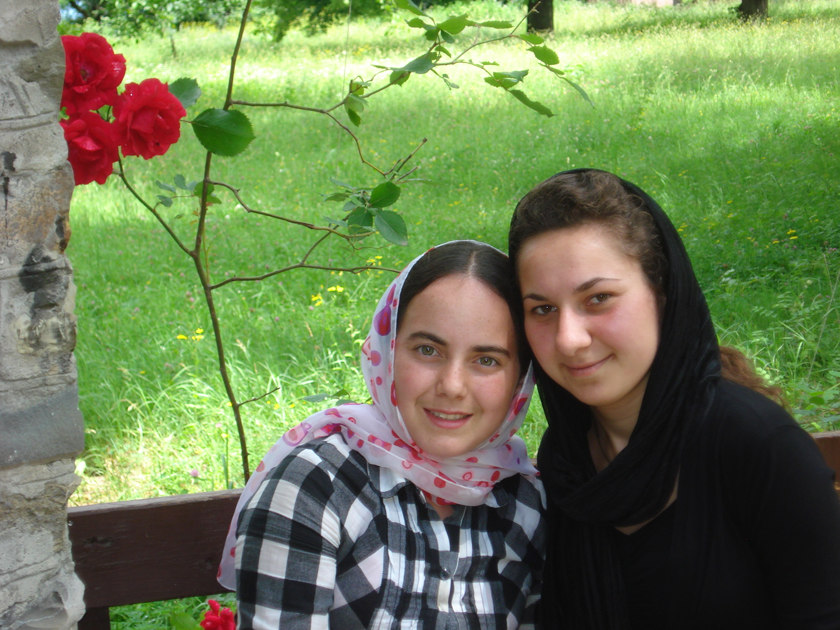 Two young Georgian girls after worship in Svetiskhoveli Cathedral in town of Mtskheta. This is considered the most venerated place of worship for Georgian Orthodox religion in the country
