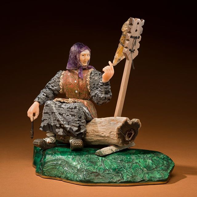 'Grandmother' is a gemstone sculpture by Ukrainian-Russian lapidary artist Vasily Konovalenko, on permanent display @denvermuseumns . The old woman spinning wool is made from Beloretsk quartz, white quartz, the wool she she spins is made from rutilated quarts, she has an amethyst head scarf, a snowflake obsidian dress, aragonite vest, and sits on a petrified wood log on top of a malachite lawn. This sculpture was produced in the 1980s after Konovalenko had emigrated to America. Photos 1 & 2 by Rick Wicker © DENVER MUSEUM OF NATURE & SCIENCE 🎥 Photo 3: 'Russian Woman Spinning Yarn, Izvedovo Village' 1910 by Sergei Prokudin-Gorskii, innovative color photographer. 💎 Photo 4: 'Young spinner. Village Mordva Cherkasy region. 1906' by an unknown photographer 🎥 Photo 5: 'Russian: Spinning' unknown source 18th century etching💎 Photo 6: 'Spinning' - Nikolay Dubovskoy - 1870. Dubovskoy was a Russian landscape painter, associated with the Peredvizhniki (realist 'Itinerant Painters' movement). 🎥 Photo 7: 'Spinning' by Vasily Tropinin 1800, a was a Russian Romantic painter who spent much of his life as a serf; he didn't attain his freedom until he was more than forty years old. 💎 Photo 8: 'A Muzhik Botching the Bast Shoes, an Old Woman Spinning Thread' first half of 19th century - unknown artist was likely a serf. Muzhik means peasant. These bast shoes worn by peasants were called lapti. #gemstones #konovalenko #russianart #sculpture #history #spinning #denver #lapidaryart #artist #russianculture #photography #documentary #art
