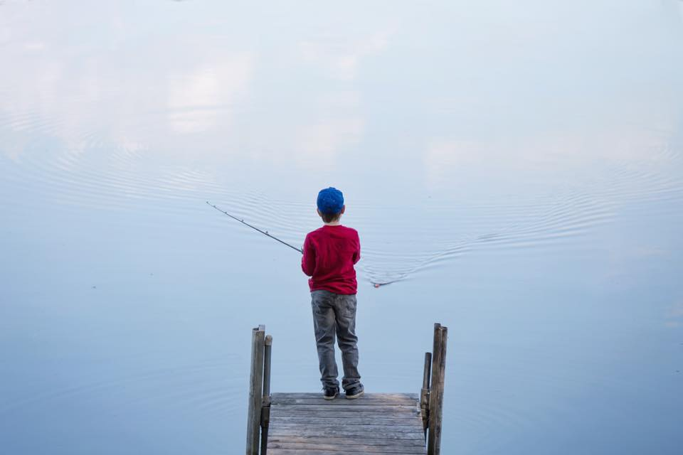 boy in blue cap fishing.jpg