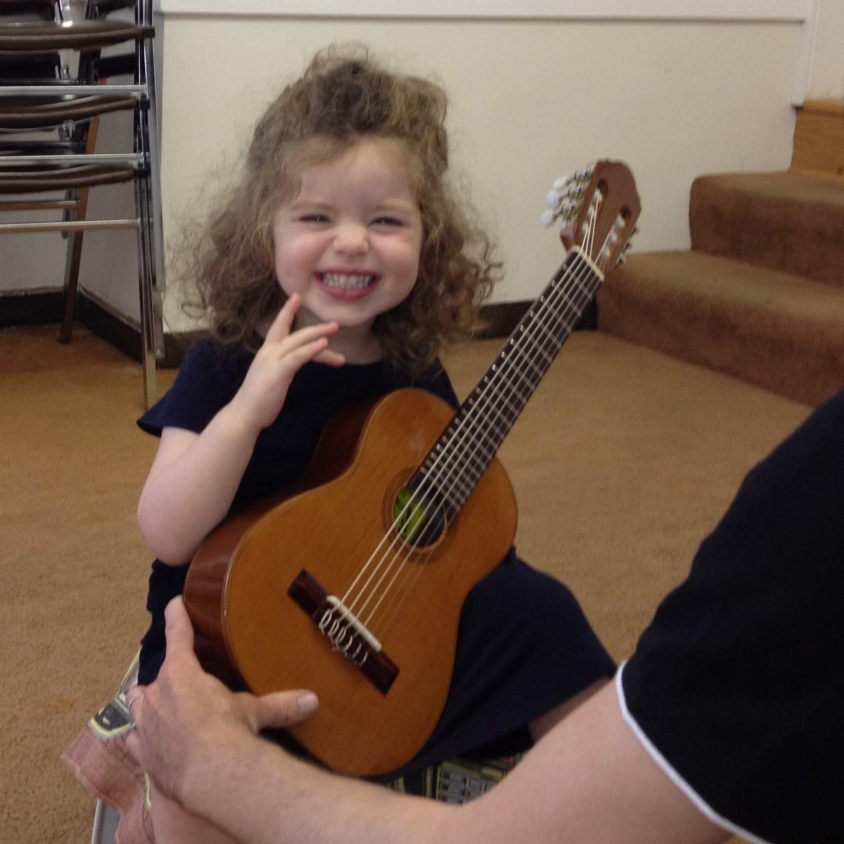 3 year old Suzuki guitar student