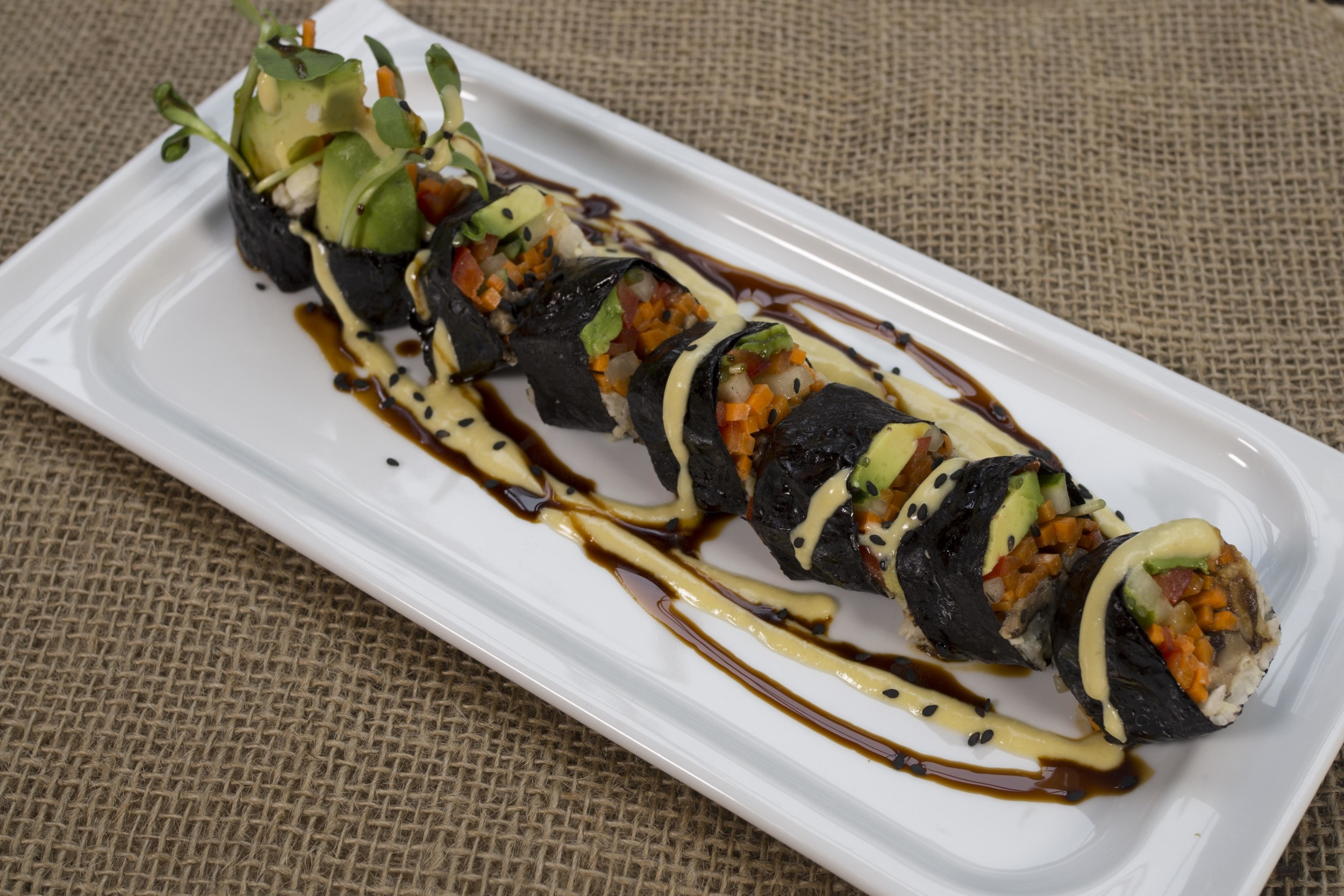 "Jicama ""rice"" spiced shiitake sushi roll (Organic vegetables, orange miso and sweet & sour tamari drizzle)"