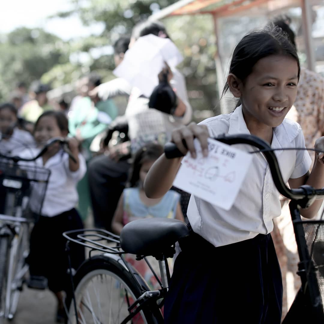 "A ""Moment of Happy"" where every girl at an ashram or shelter receives her new bike. Photo courtesy of 88bikes."
