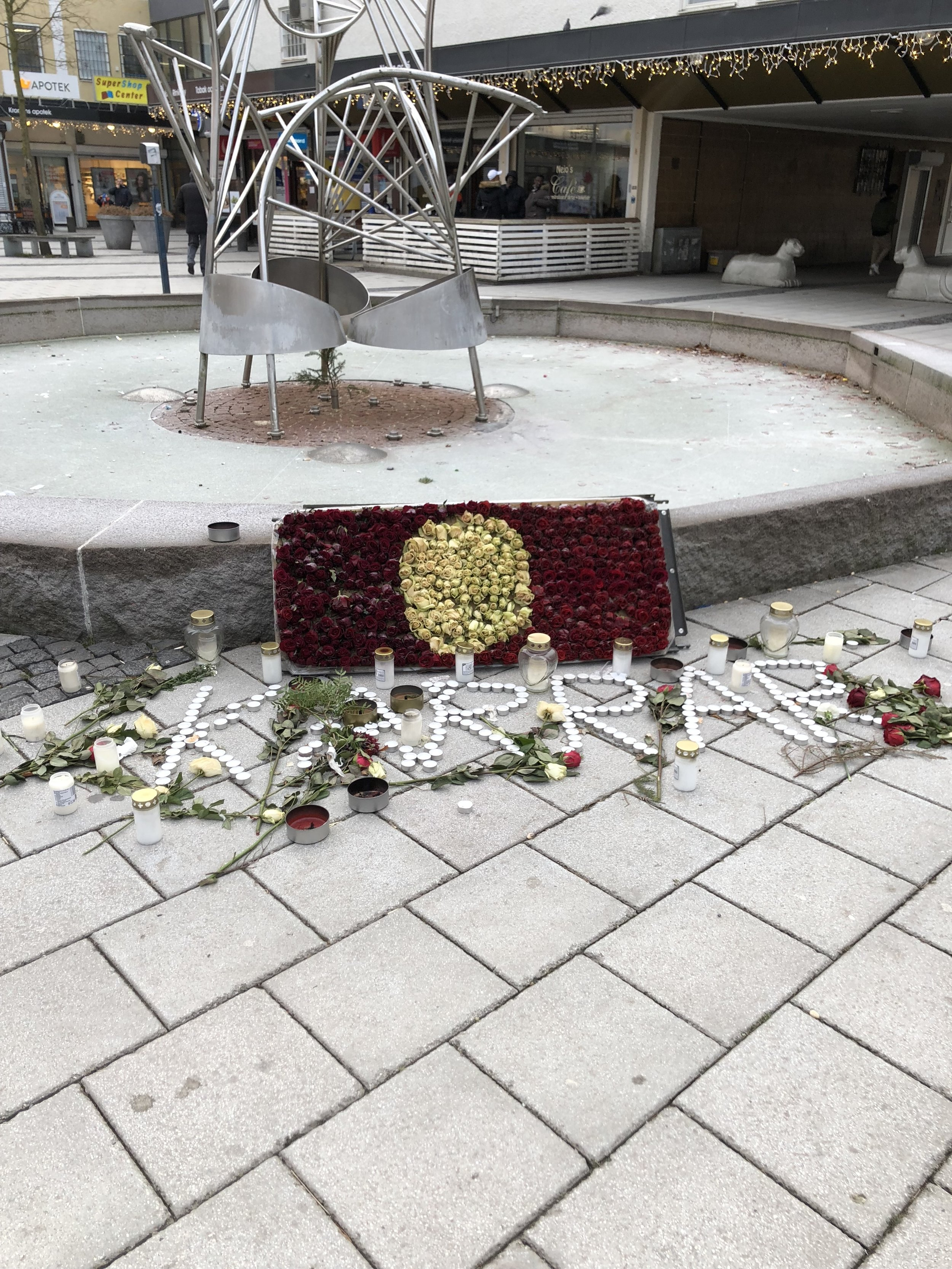Memorial for young man murdered in same square as pizza shop and mosque approx 10 days ago.