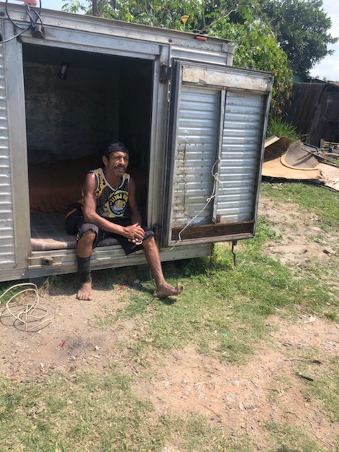 The informal security guard of the favela (slum). We had to get his permission to enter. He sits in the entrance of his house.