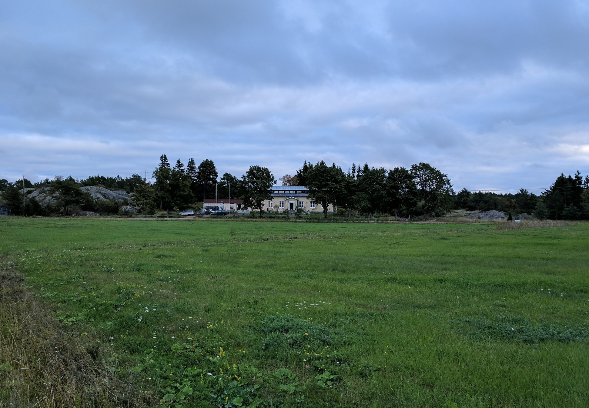 a view of the hotel from across a meadow