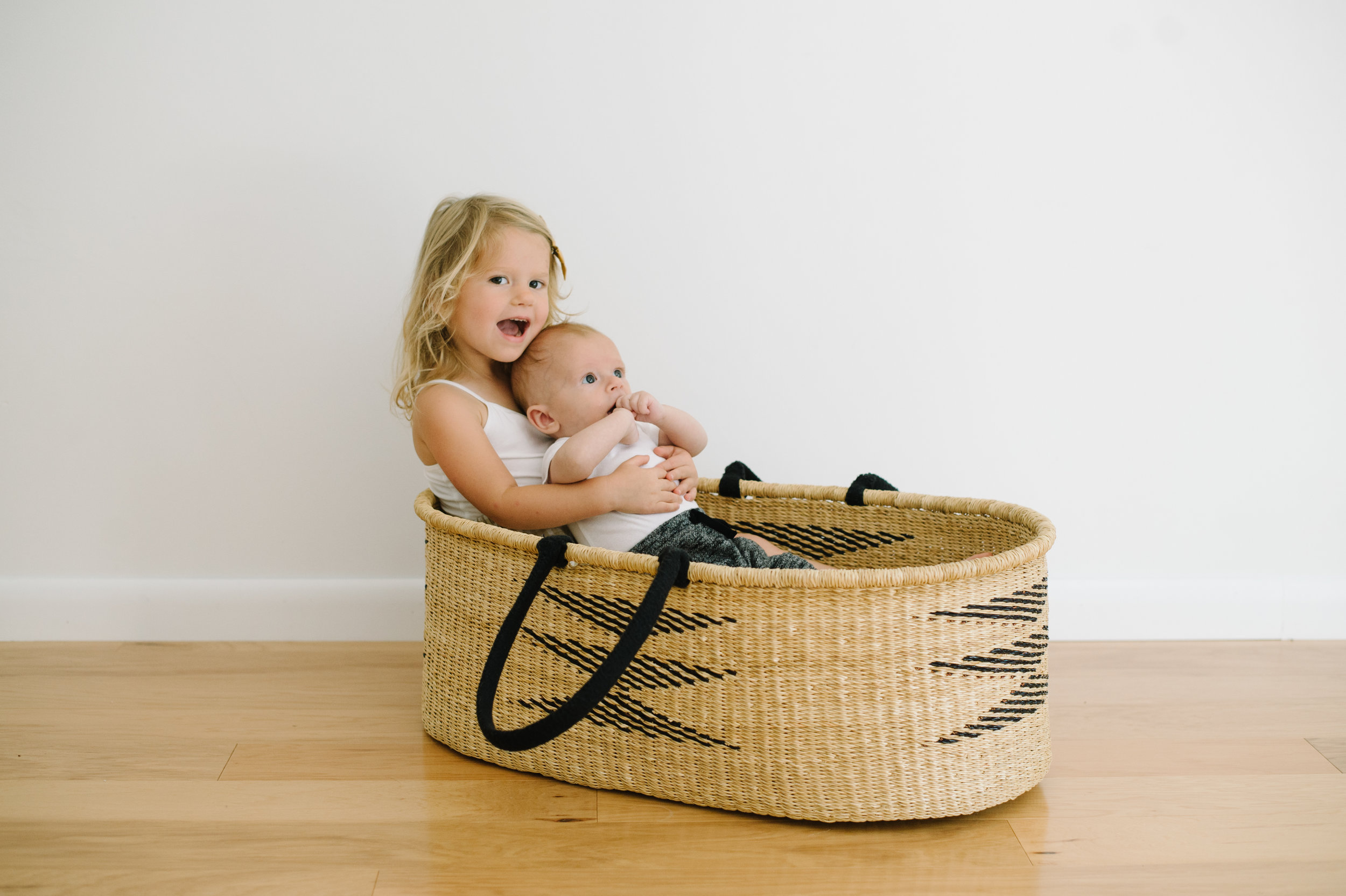 What's cuter than a baby in a basket? Your baby holding your other baby, I think. June is so proud to be holding Graham in his bassinet for his three month photos.
