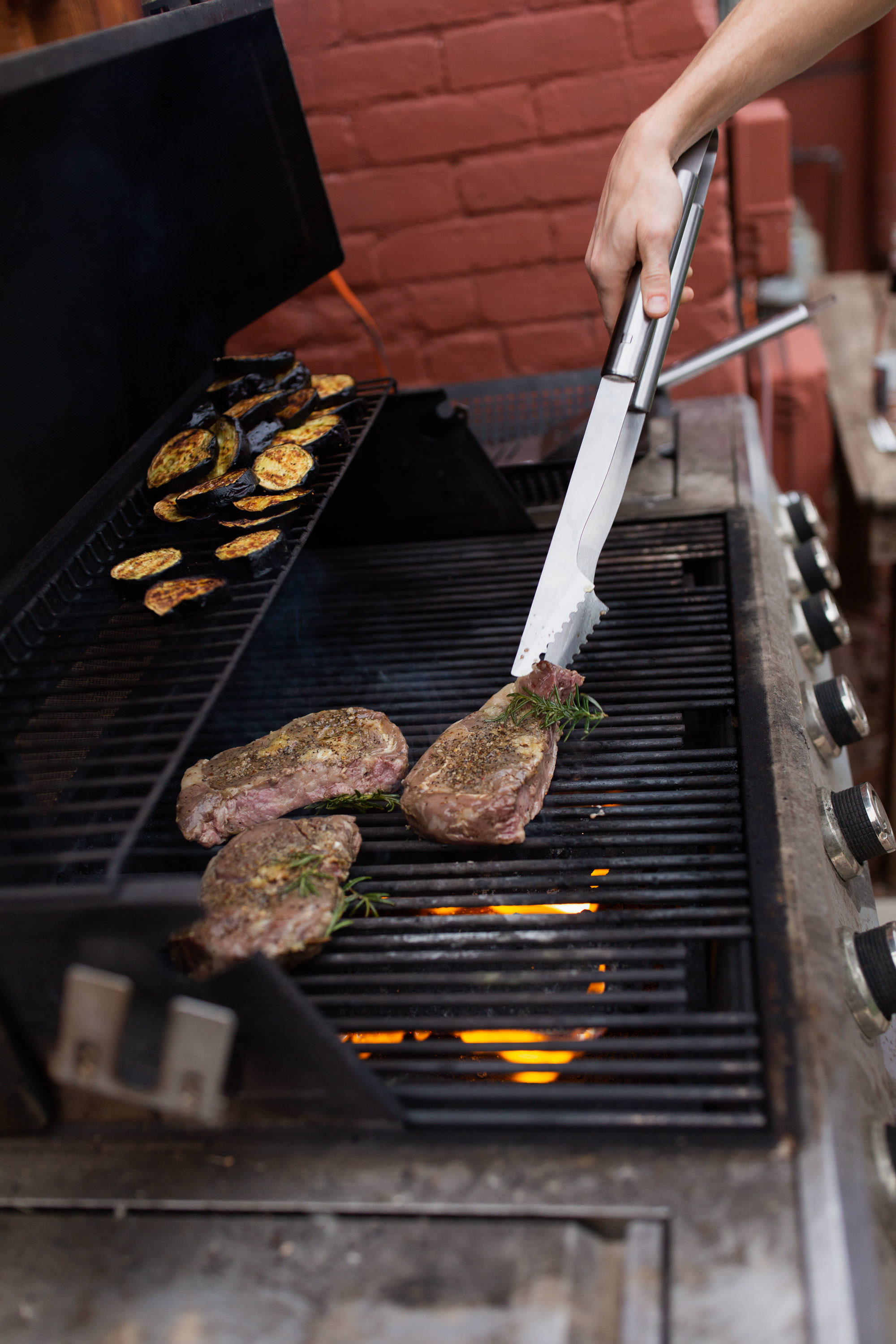 finishing up sous vide steaks on grill