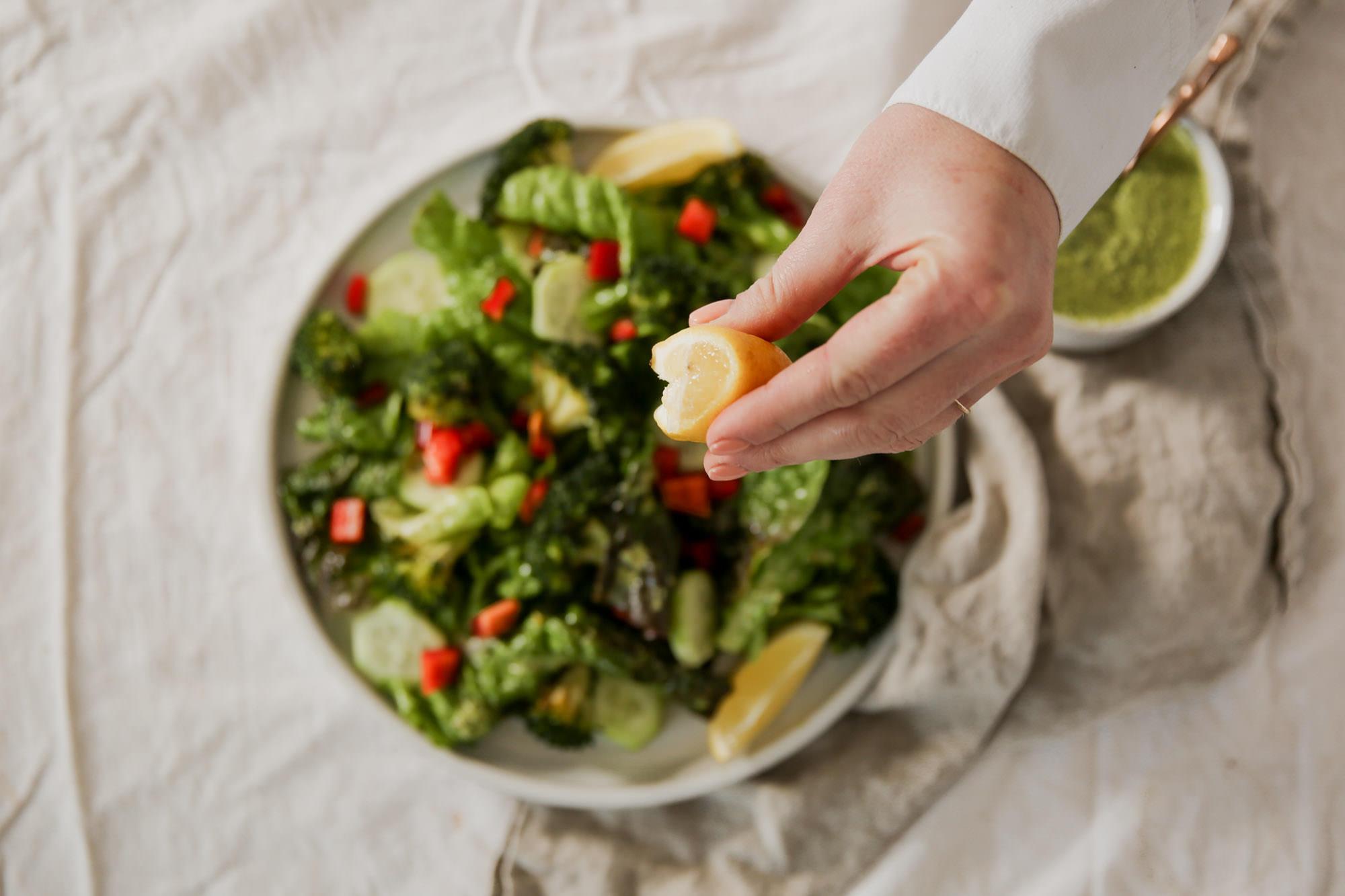 Spritzing Fresh Lemon On Salad
