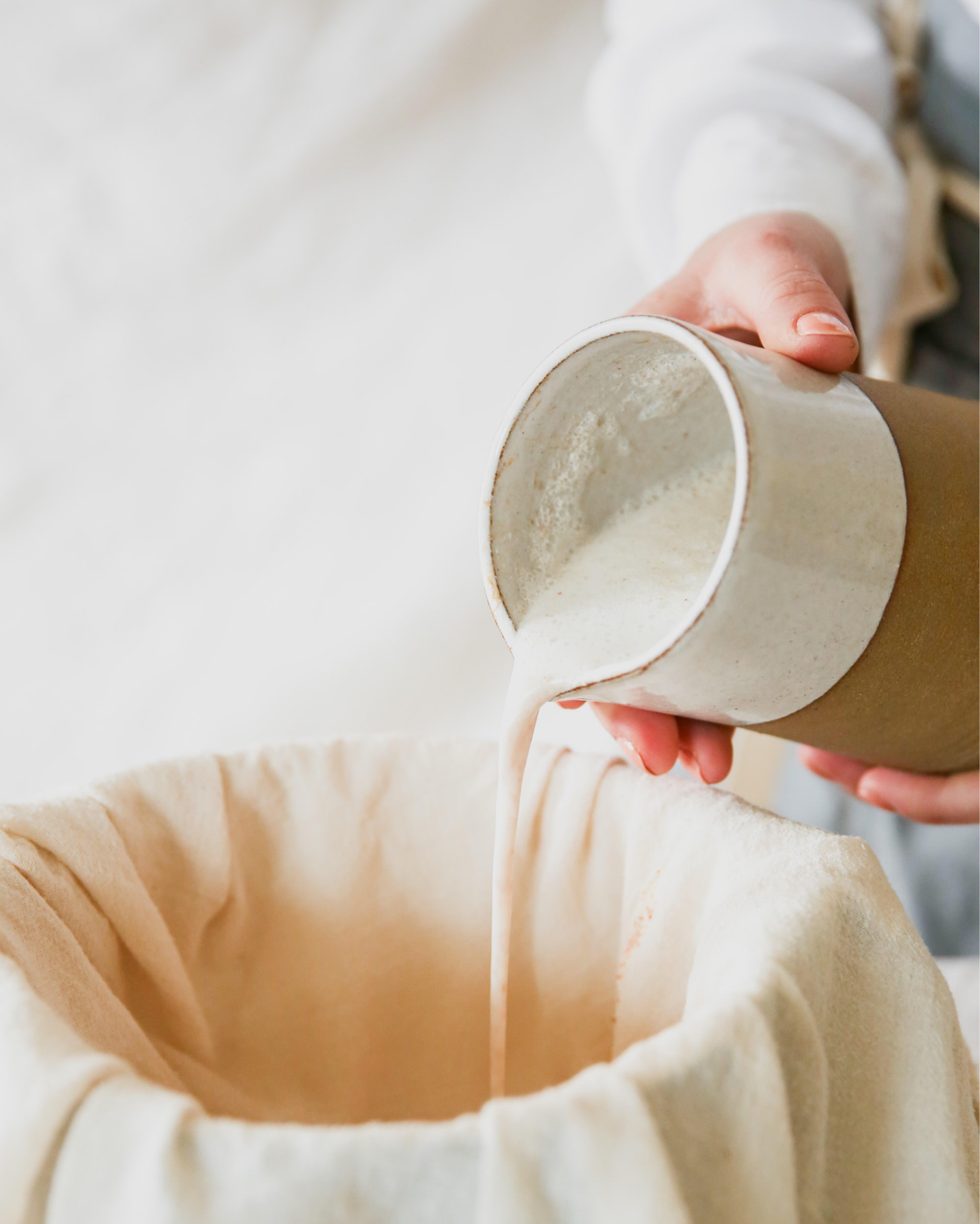 Pouring+Blended+Almond+Milk+Into+Cheesecloth