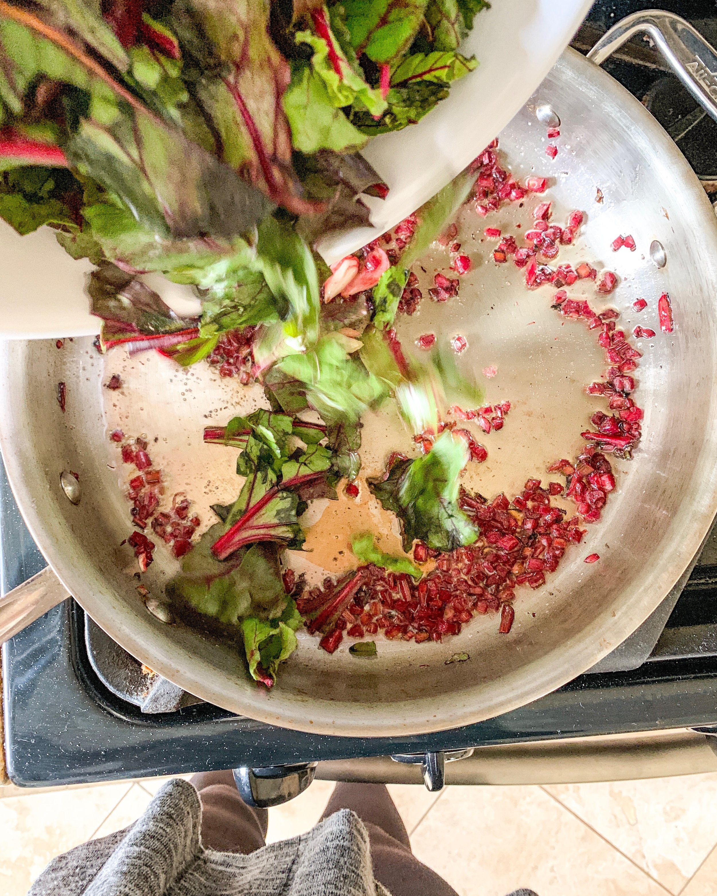 adding+beet+greens+to+a+saute+pan.jpg