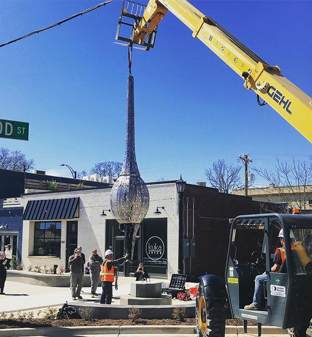 Our new public art in our village plaza is being placed today!  We can't wait to see it lit up!