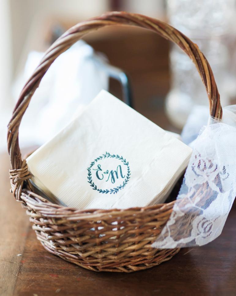 The couple's wedding logo on cocktail napkins