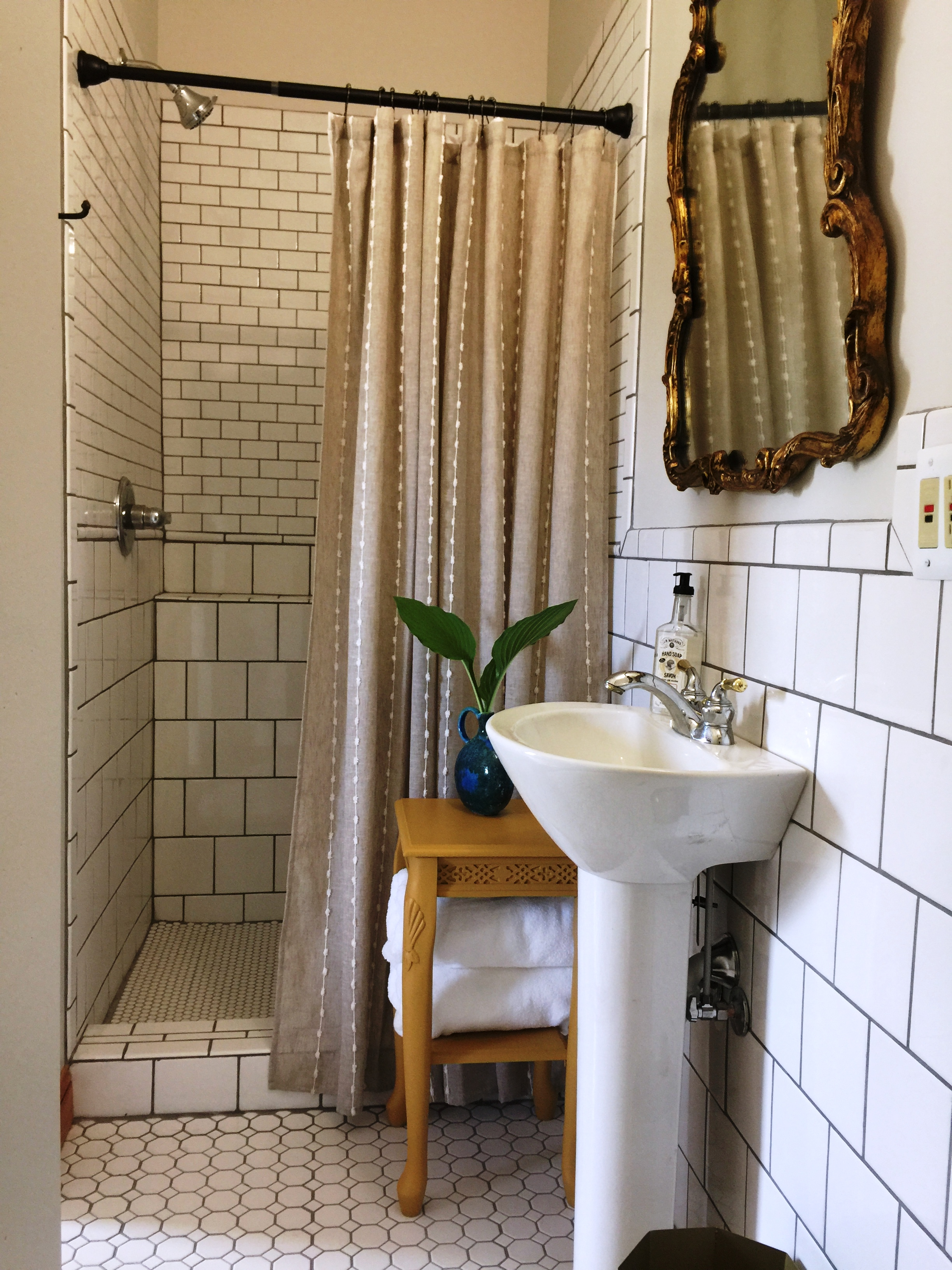 Sorry for the bad Iphone pic — but I had to show you this space. This used to be an over sized tub in the middle of the room. Now it has a wall and a usable shower — go figure! Outdated Victorian Inn turned into a  fabulous vacation rental.