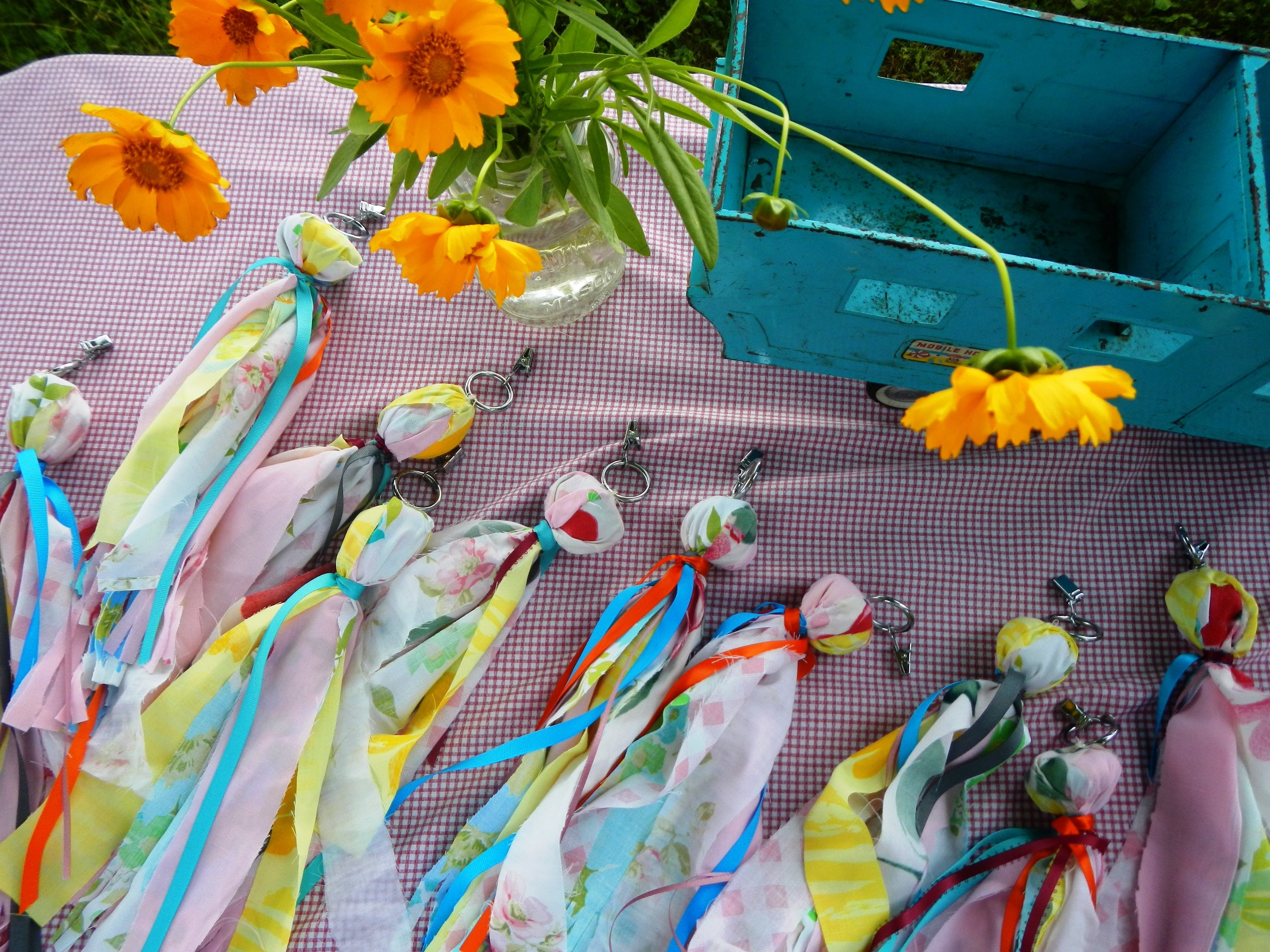 Made these Picnic Clips Weights to Keep the Picnic Table Cloth from blowing around. So much fun. A rock, a curtain clip and some vintage colorful sheets and ribbons — fun and easy.  Here is the STEP BY STEP on DIY NETWORK.