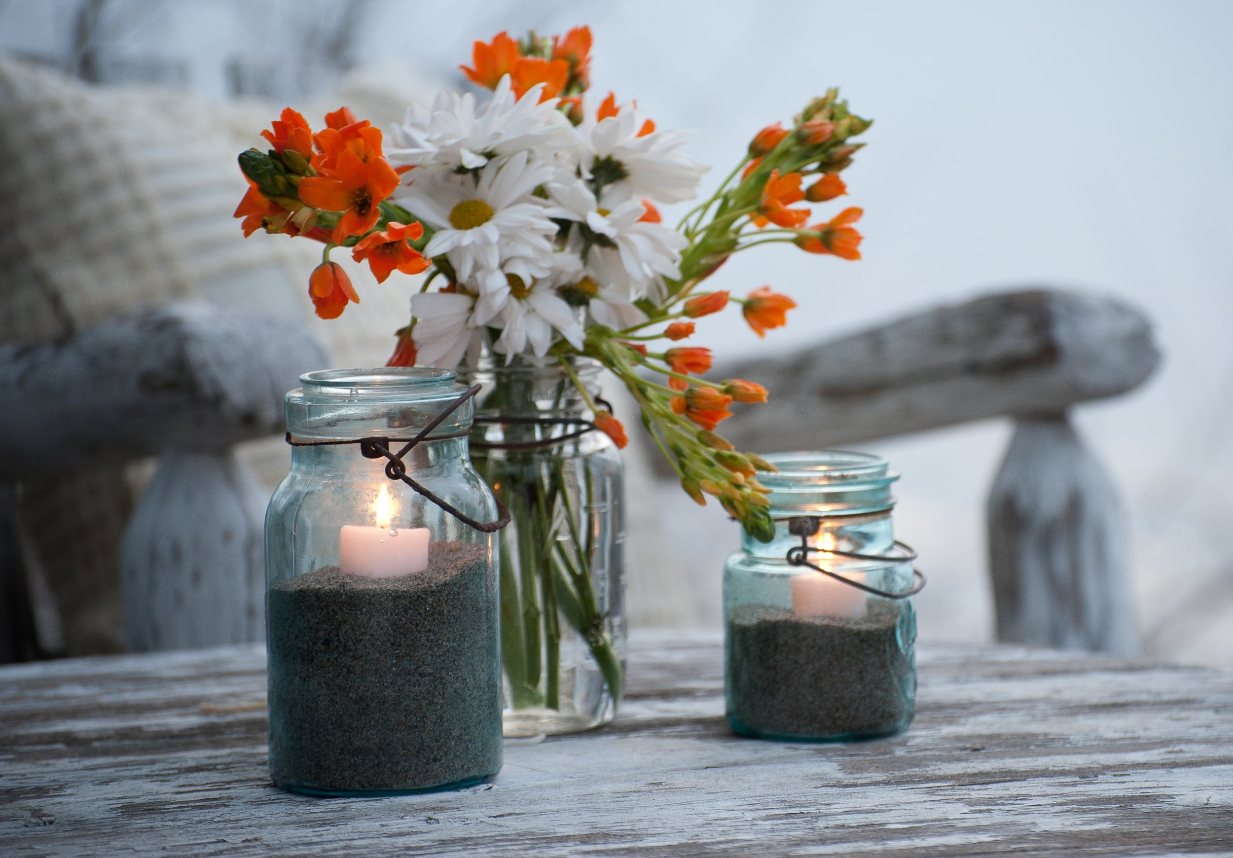 Love old canning jars, especially the blue ones. If you are going to use them with candles, make sure the flame is close to the top so you don't heat up the inside as much. I love this spring shot that  Susan Teare  took…