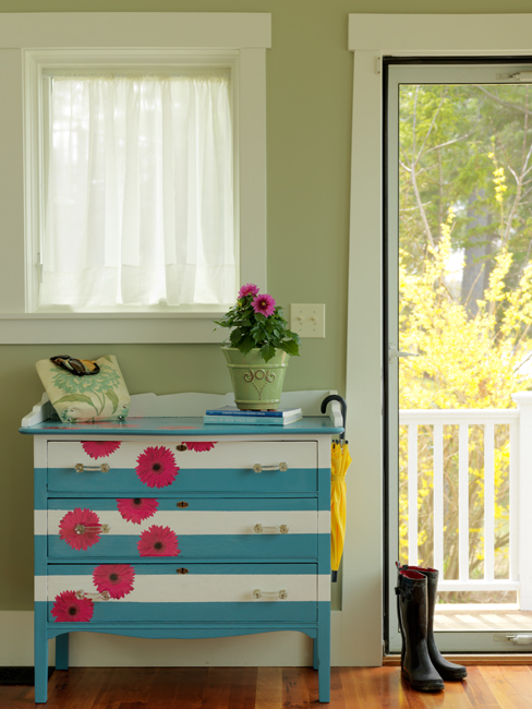 I really can't do a SPRING DIY COLLECTION without this baby!! One of my favorite dresser redos— painted with blue and white stripes and some pink paper flowers.  HERE ARE 19 PAINTED DRESSERS — YOU'LL SEE A COUPLE OF MINE IN HERE… HAPPY SPRING DIY HERE!