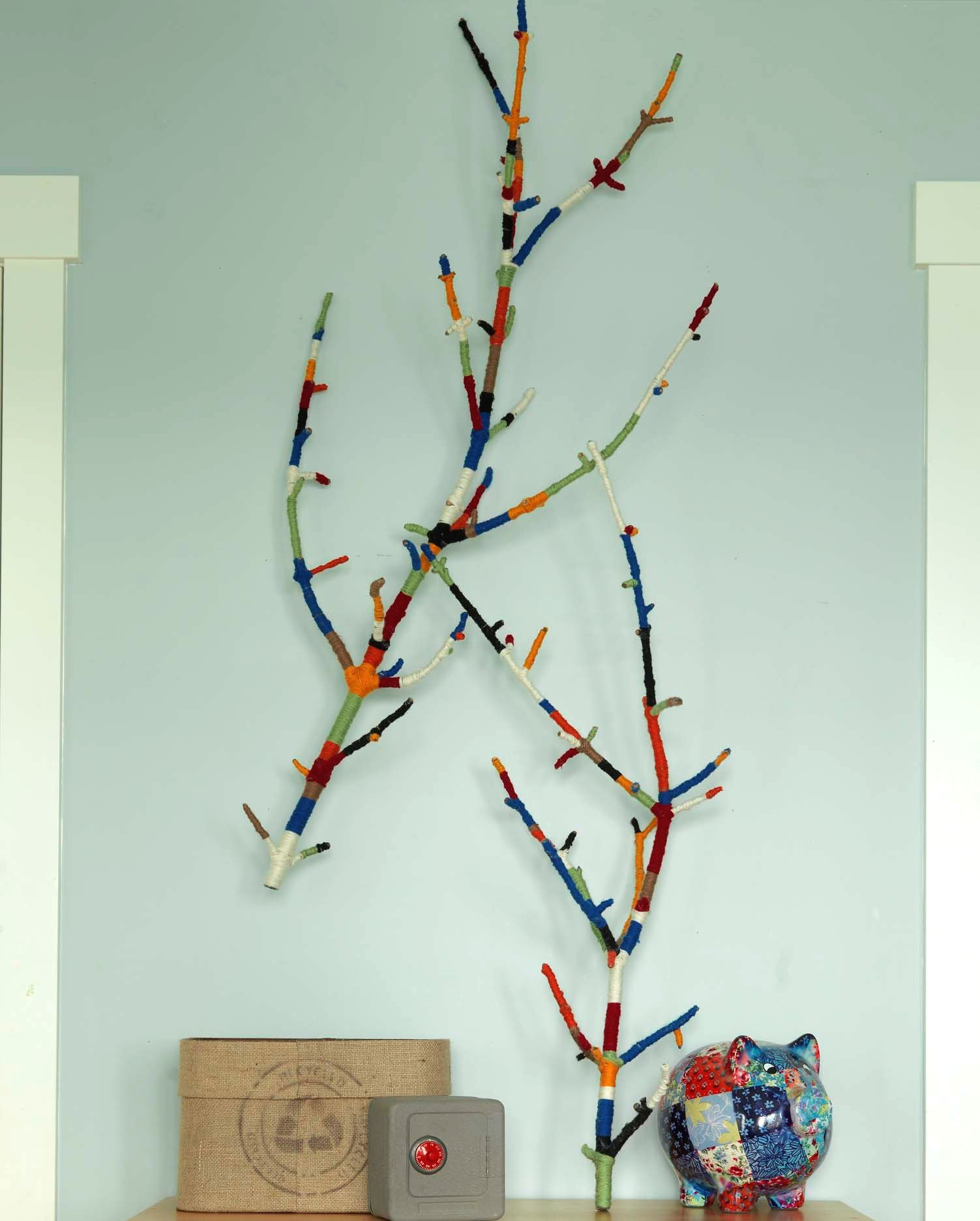 A little yarn and a couple of sticks — and a glue gun! MIKE DROP. This easy (but a little time consuming) DIY is in my book , Salvage Secrets Design and Decor.