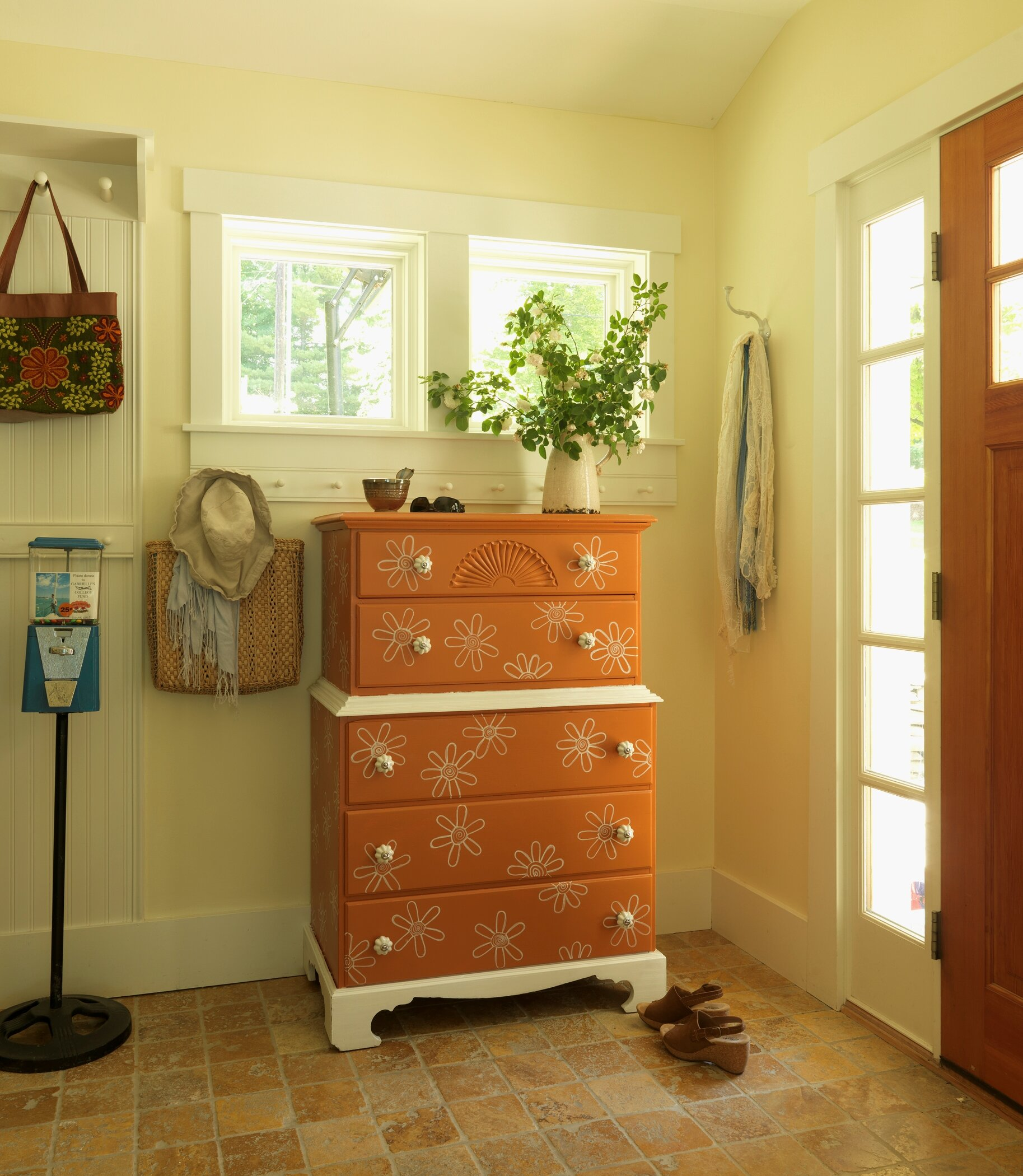 I painted an  old outdated dresser giving it an orange retro look . A DIY NETWORK project.