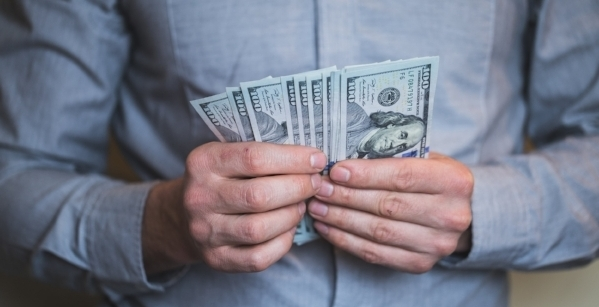 businessman-holding-money-in-his-hands-PRBS4F3.JPG