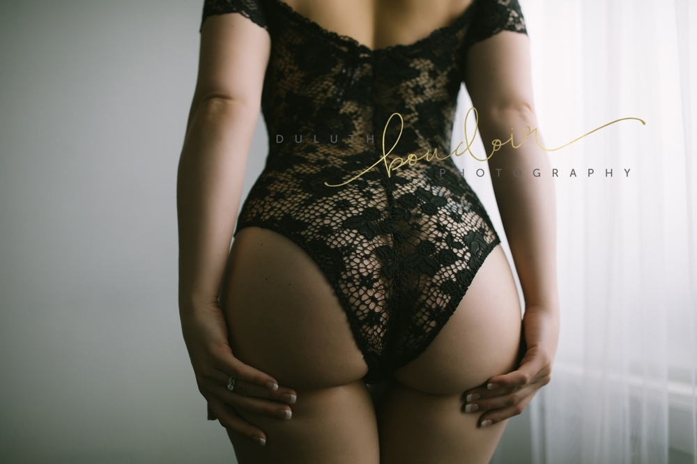Ari wearing a Victoria's Secret bodysuit for her boudoir photography session in Duluth, MN