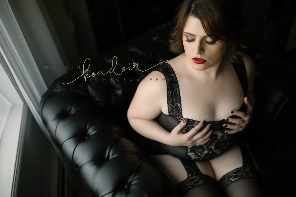 Angie wearing black lingerie with red lips for her boudoir photography session in Duluth, MN