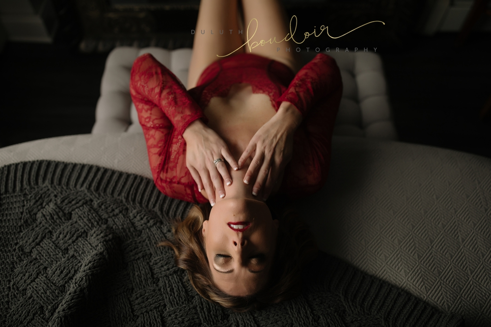 red bodysuit from Victoria's Secret | Jen at Duluth Boudoir Photography in Minnesota | boudoir photography on a bed