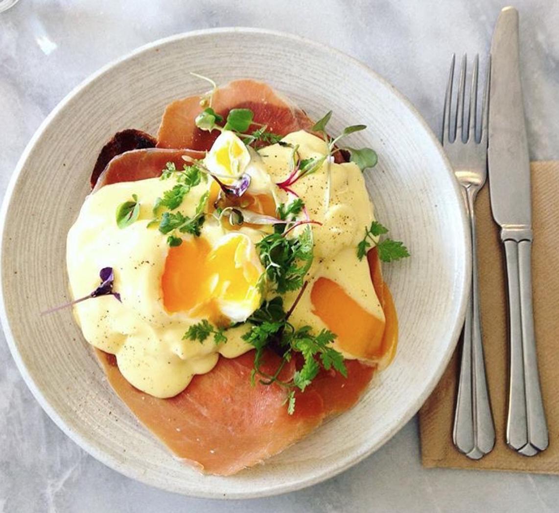 EGGS BENEDICT - Poached eggs & jamon serrano with verjus hollandaise on organic sourdough.