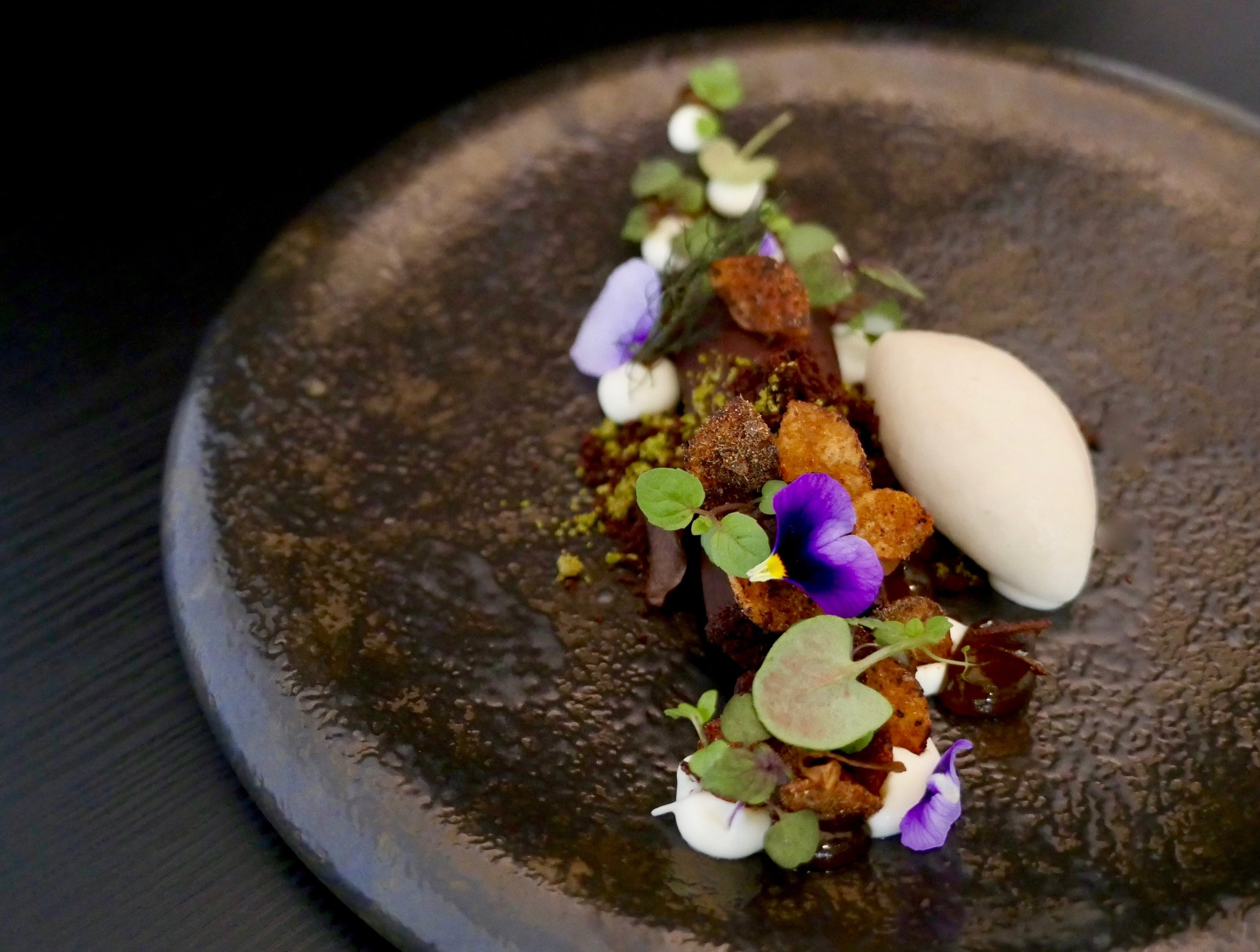 """AUTUMN FOREST"", SOFT ROASTED MILK CHOCOLATE FILLED LOG. CHOCOLATE SOIL, YOGURT, CARAMEL GEL, PORCINI POTATO CHIPS, FRIED SHIITAKE MUSHROOMS, APPLEWOOD ICE CREAM."