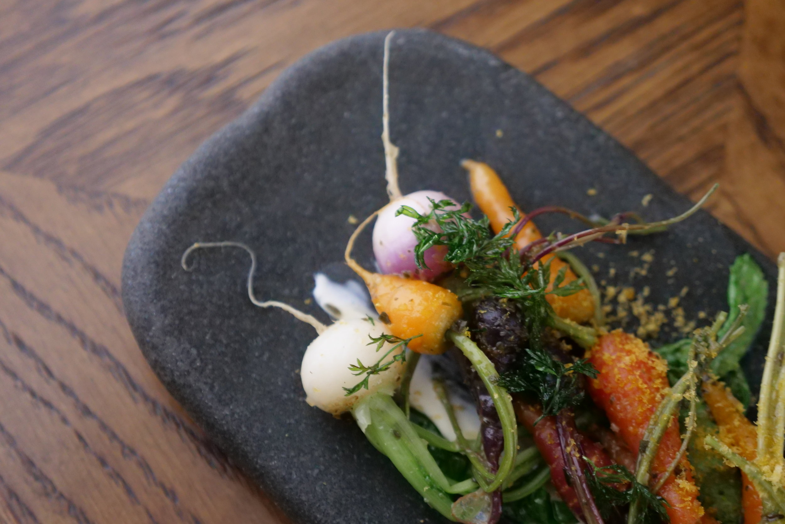 PETITE BOUCHE VEGETABLES, KOUMBOU, CREME FRAICHE, BOTAGO AND FRIED CARROT TOPS.