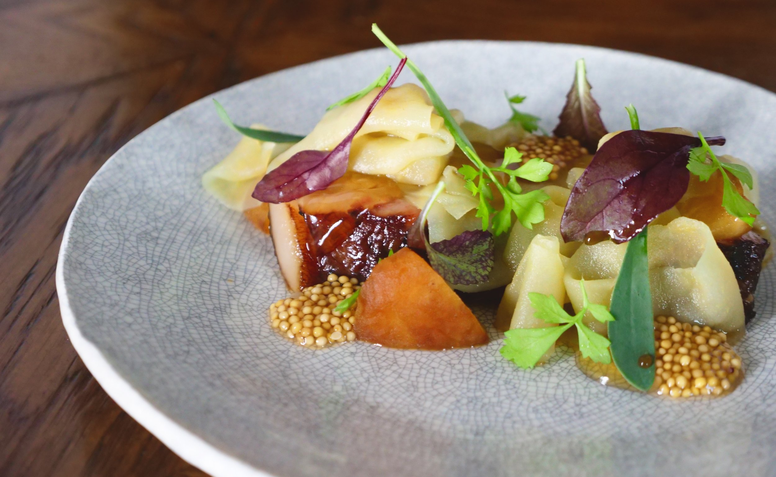 HICKORY SMOKED PORK JOWL, APPLE RIBBONS, CHARRED GALA APPLE, PICKLED MUSTARD, HONEY GEL & HERBS.
