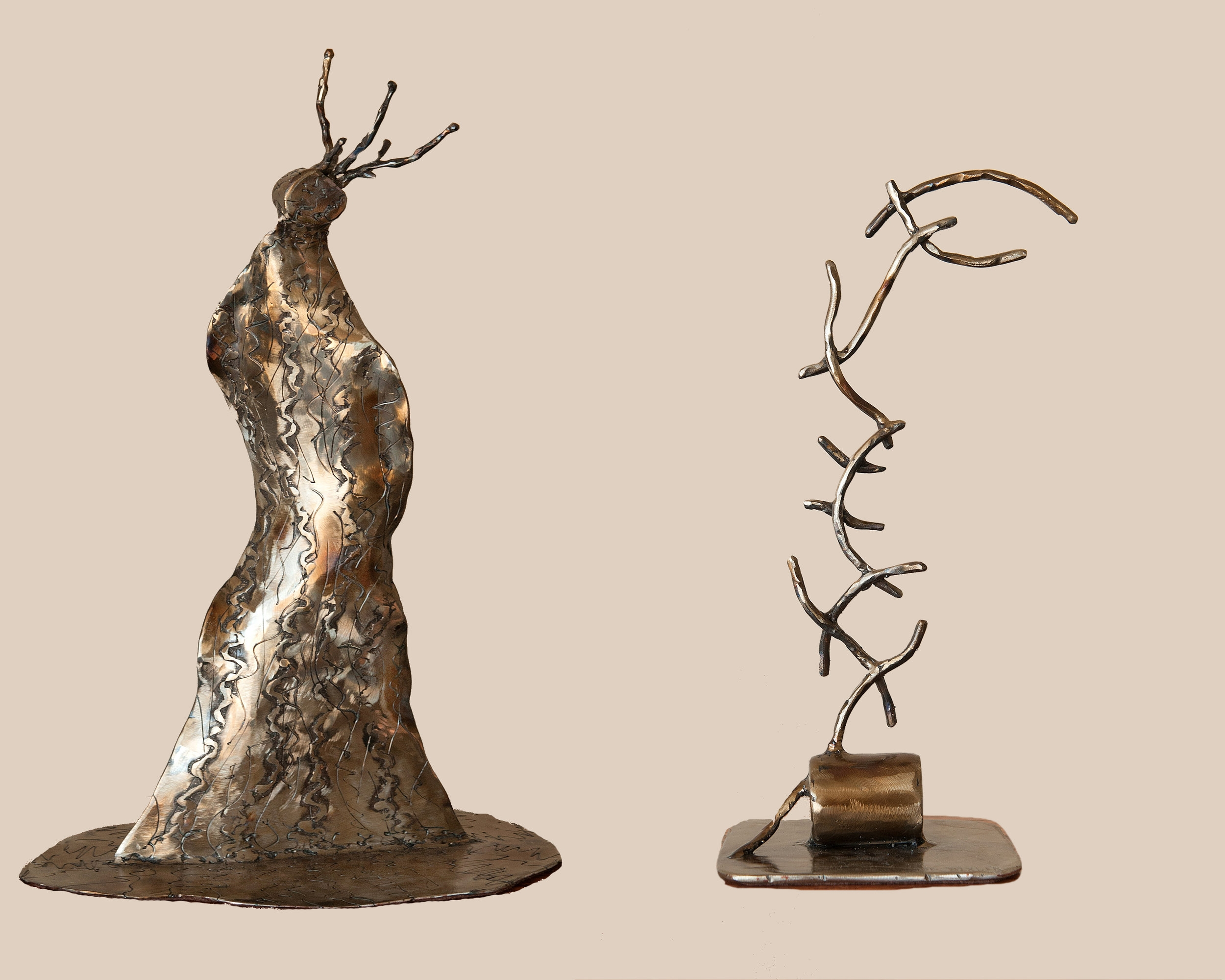 """""""Feel for Life"""" Sculpture (left)  &  """"Connect"""" Sculpture (right)"""