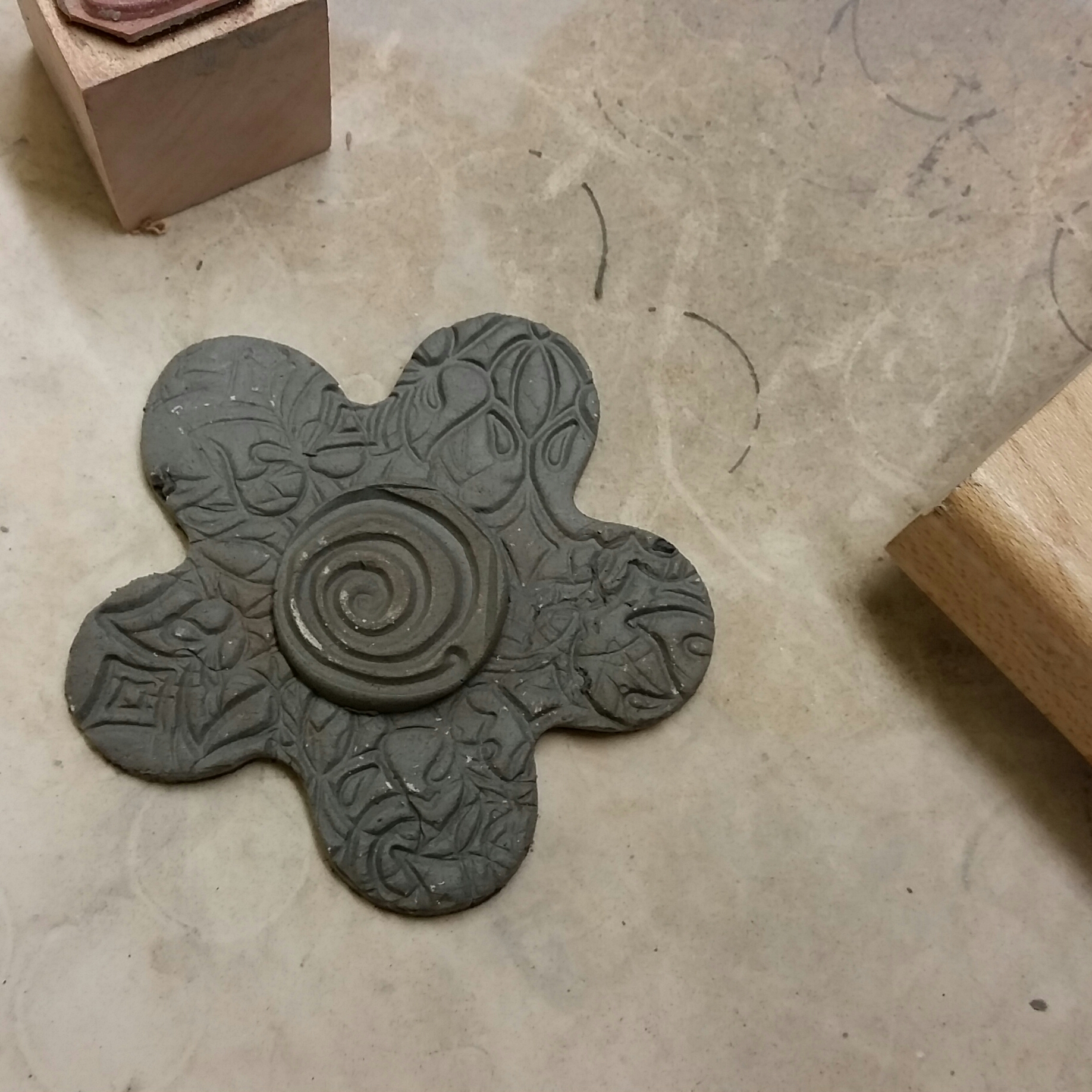So, I did create a group of clay flowers with a lots of texture using new stamps I found at the thrift shop.